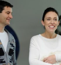 New Zealand Prime Minister Jacinda Ardern carries her newborn baby as she walks out of the Auckland Hospital in New Zealand