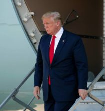 U.S. President Donald Trump walks from Air Force One as he arrives in Dallas, Texas