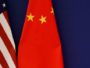 FILE PHOTO: U.S. President Donald Trump delivers his speech next to U.S. and Chinese flags as he and Chinese President Xi Jinping meet business leaders at the Great Hall of the People in Beijing