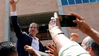 Venezuelan opposition leader Juan Guaido arrives in Caracas